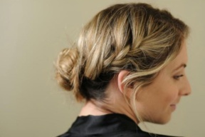 French braid bangs and secure at base of ponytail and wrap remaining hair in a bun