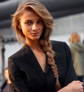 Braid hair to the side and pull loose pieces towards the front and top for extra volume